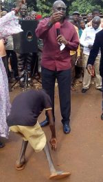 Photos: Gov. Fayose Turns Prophet,'Orders Crippled Man To Walk' In Ekiti