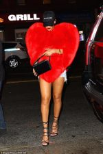 Fashion Girl! Rihanna Steps Out In Gigantic Red Fox Fur Cape Worth Over N6.5 Million(Look)