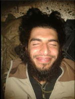 Militant Smiles After Being Killed In Syria