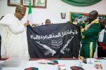 PHOTOS: Army Presents Captured Shekau Flag To President Buhari