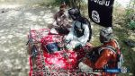 Irony: Pictures Show Boko Haram Fighters Reading From A Laptop