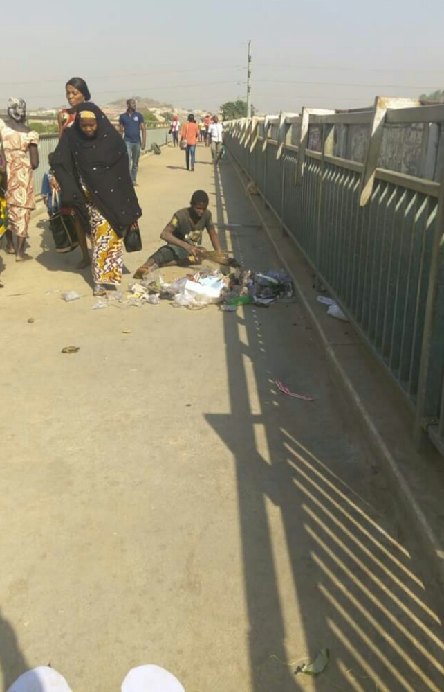 Two Handicapped Men Spotted Sweeping A Bridge In Abuja