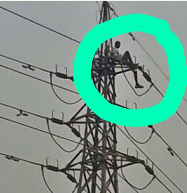 NA WA!!! Ghana Man Climbs High Tension Pole And Demanding For Money From The President-elect