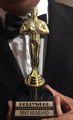 "LOL! Woman Awards Husband With Exact Replica Of an Oscar Award Stating ""Best Husband"""