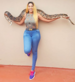 Bold Or Deadly? Nollywood actress, Rukky Sanda Strikes Poses With Huge Python [Photos]