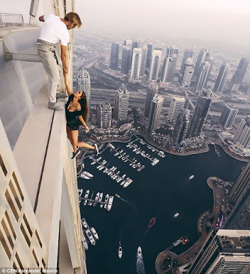 Police Arrests Instagram Slay Queen For Risking Her Life  To Take Perfect Shots On Roof Of a Skyscraper [Photos]