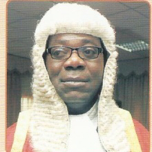 Justice Aladetoyinbo And His Contradicting Rulings: Tenants Of U.L.O. Plaza Storms FCT High Court