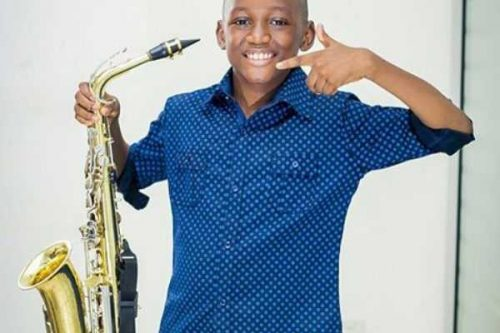 2face's Eldest Son, Nino Who Is A Saxophonist Shows Off Impressive Medal Collection