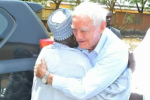 Photos: Islamic Cleric and Catholic Priest Share Emotional Farewell Embrace as He Returns To Ireland After 50 Years In Nigeria