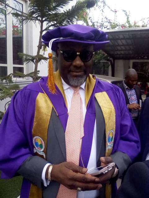 Drama King! Senator Dino Melaye Shows Up at Plenary Session Dressed In Convocation Gown [Photos]