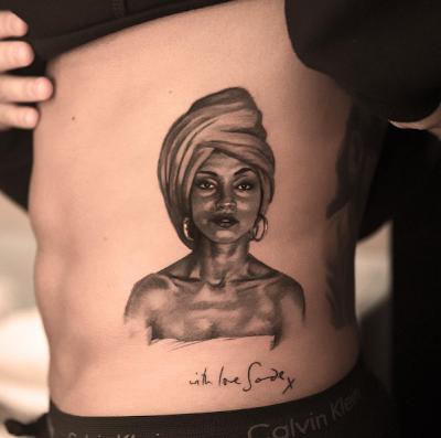Drake Tattoos Image Of Nigerian Singer, Sade Adu On His Body [Photos]