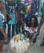 Miracle Model, Olajumoke Spotted Sharing 'Bread and Butter' To Random People On The Street [Photos]