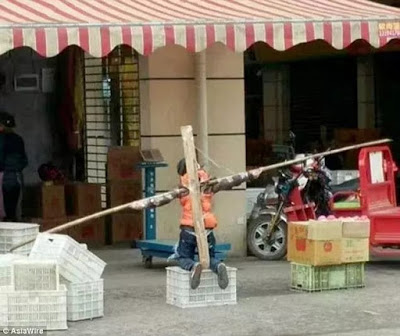 For Real?Father Crucifies Son With Makeshift Cross For Failing To Do His Assignment