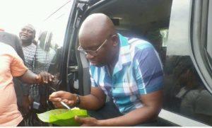 Fayose Stops By Roadside 'buka' To Eat Rice [Photos]