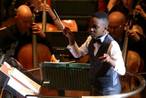 Matthew Smith: 11 Year Old Prodigy Becomes World's Youngest Orchestra Conductor After Leading Mass Orchestra