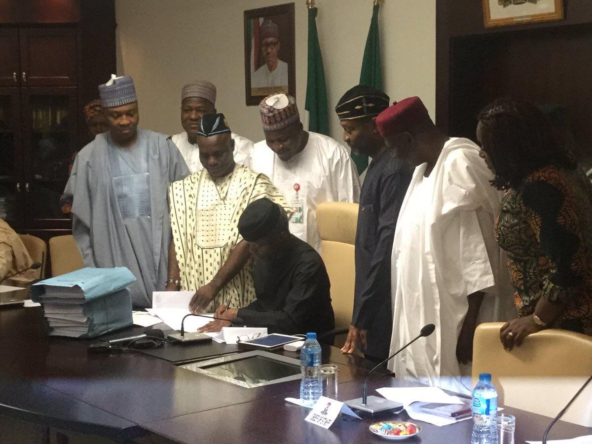 Breaking! At Last, Acting President Yemi Osinbajo Signs  2017 Budget Into Law