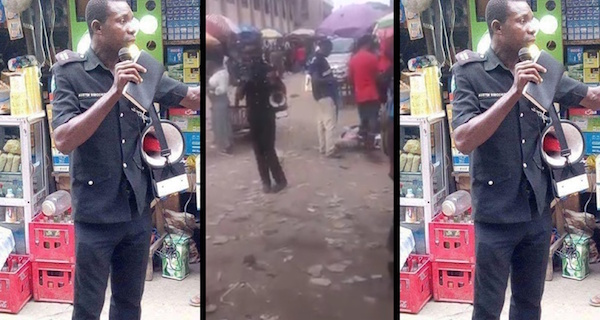 Photos, Video: Policeman Pictured Preaching  At Alaba International Market