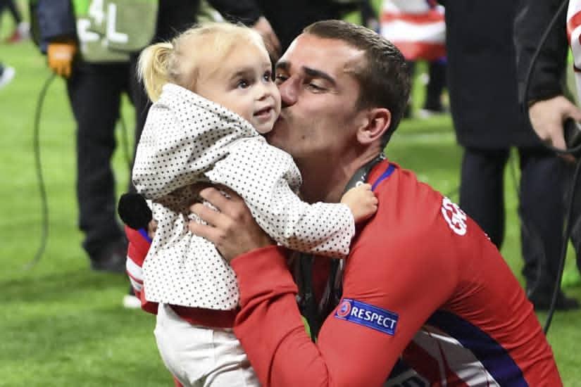 Grieizmann with his first child
